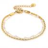 Goudkleurig verstelbaar armbandje met witte kraaltjes