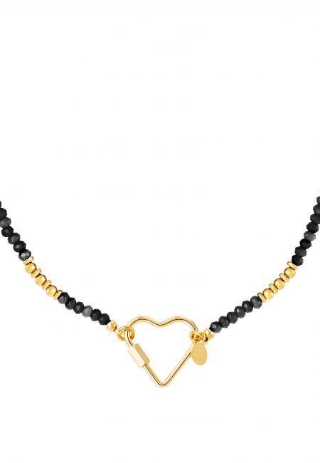 Goudkleurige ketting met hart en kraaltjes